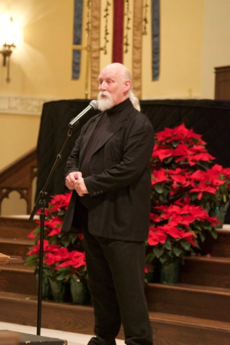 Artistic Director and Conductor Timothy Waugh speaking to the audience at a December 2015 holiday concert.